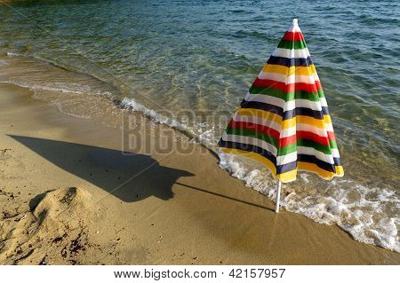 Colorful Umbrella On The Seashore