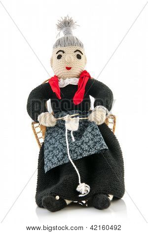 hand knitted grandma sitting on chair and knitting