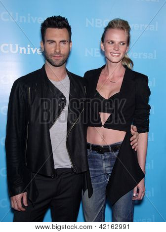 LOS ANGELES - JAN 06:  ADAM LEVINE & FIANCE' arriving to TCA Winter Press Tour 2012: NBC Party  on January 06, 2012 in Pasadena, CA
