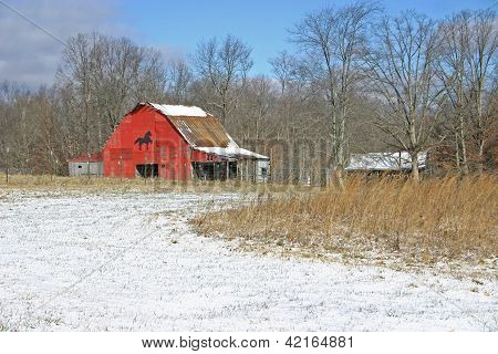 Red Barn in Snowy Field