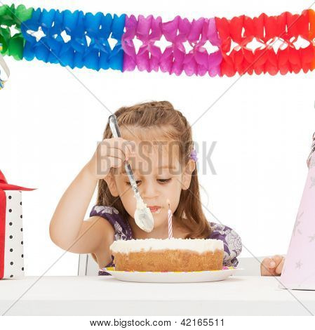 bright picture of beautiful litle girl with birthday cake