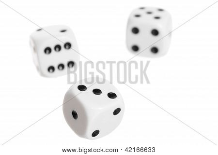 Three Falling Dice, White Background.