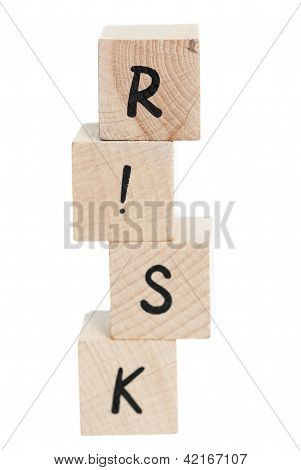 Risk Tower Spelt With Wooden Blocks.