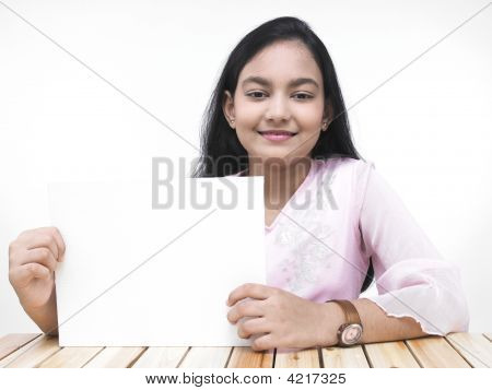 A Pretty Asian Teenage Girl With A Blank Placard