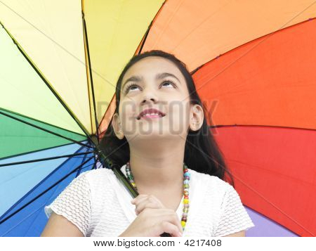 Girl Of Indian Origin With A Rainbow Umbrella