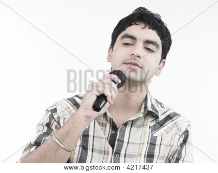 Asian Male Of Indian Origin Singing A Song