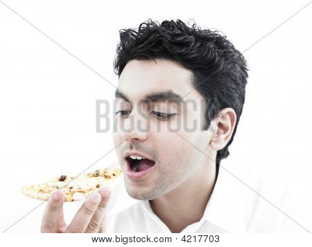 Portrait Of A Smart Looking Asian Man Eating Pizza