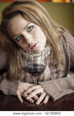 Young Woman With Beautiful Blue Eyes Drinking Red Wine