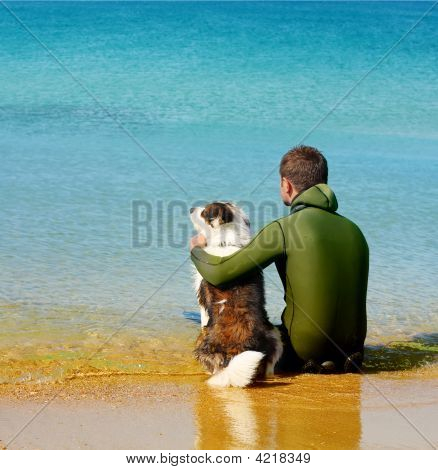 Photo Of Men And Dog Siting In The Water