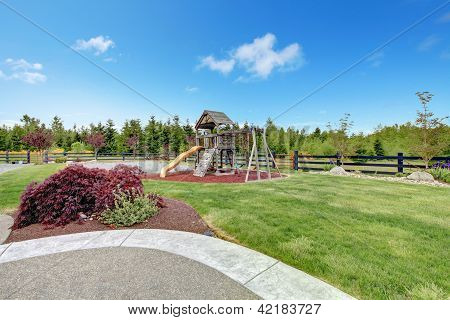 Large Luxury Home Back Yard With Play Ground For Kids.