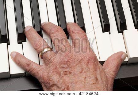 Old Hand On Piano Keys