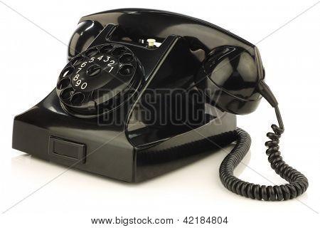 vintage bakelite telephone on a white background