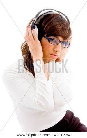 Side View Of Woman Holding Headphone