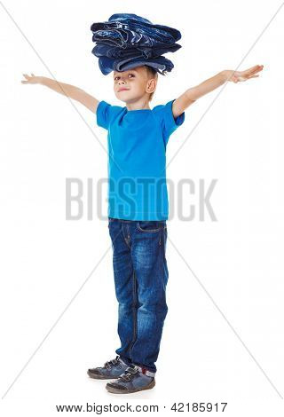 Boy in blue clothing holding denim wear pile on head