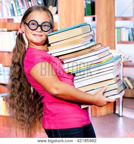 School student in goggles holding books in hands