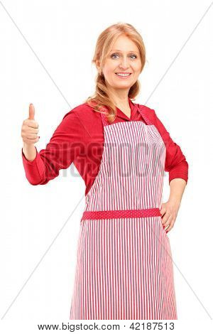 A female manual worker wearing an apron and giving thumb up isolated against white background