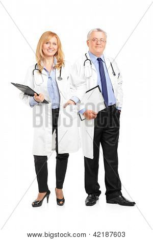 Full length portrait of a team of doctors holding a clipboard and posing isolated on white background