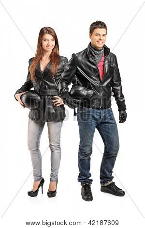 Full length portrait of two young motorcyclers in a leather jacket posing isolated on white background