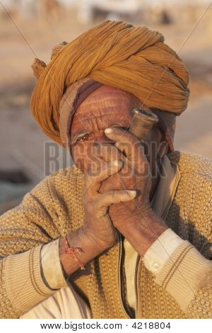 Old Man Smoking A Pipe