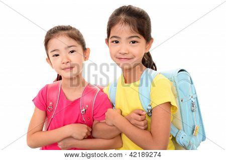 Smiling Asian schoolgirls