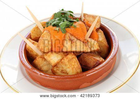 patatas bravas, fried potatoes with a spicy tomato sauce, spanish tapas cuisine