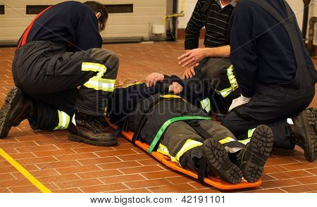 Firefighters rescue man on the stretcher