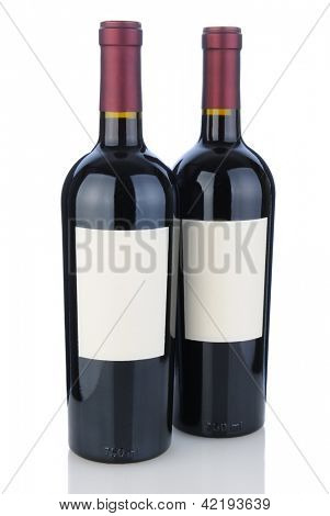 Two cabernet sauvignon bottles on white with reflection. Bottles have blank labels ready for your design or copy.