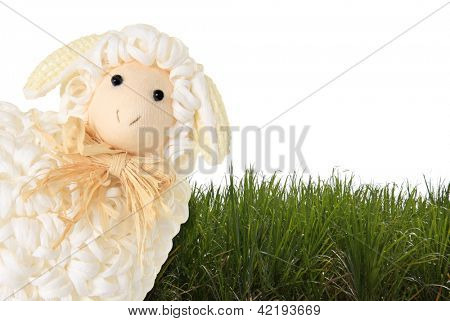 Easter sheep and grass on a white background.