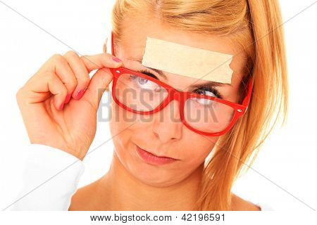 A picture of a blond confused woman with a tape on her forehead and space for your text