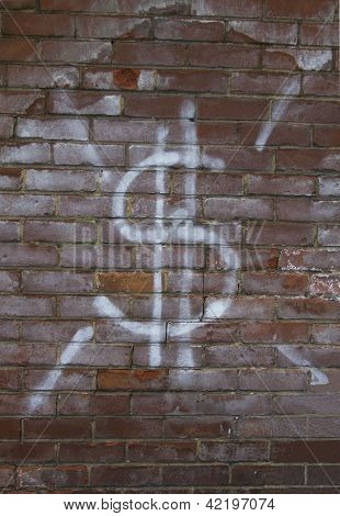 Dollar sign on brick wall