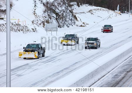NORWALK,CT - FEBRUARY 09:  Plow trucks  on I-95 after winter storm in Norwalk on February 09,2013