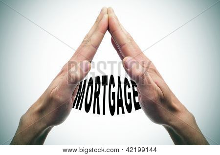 man hands forming a house with the word mortgage written inside