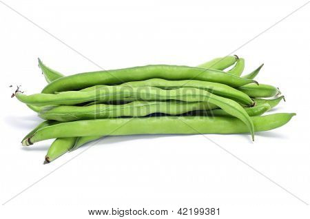 closeup of some broad bean pods with the beans inside on a white background