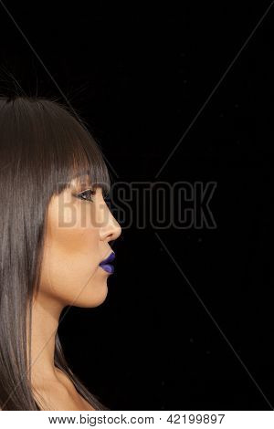 Side view of beautiful woman against black background