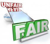 picture of disadvantage  - The words Fair and Unfair balanced on a see - JPG