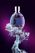 Perfume Bottle On Water Splash