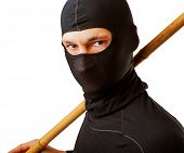 image of ninja  - Close up portrait of male ninja in black mask covered his face - JPG