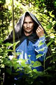 stock photo of sorcerer  - Fantasy foto of handsome mystery man with medieval sword - JPG