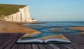 stock photo of sisters  - Creative composite image of seascape in pages of magic book - JPG