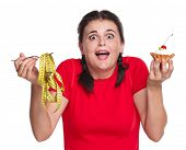 foto of greedy  - Crazy greedy girl with cake isolated on white background - JPG