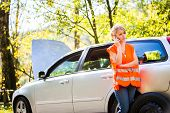 stock photo of down jacket  - Young female driver wearing a high visibility vest - JPG