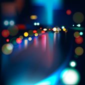 Blurred Defocused Lights of Heavy Traffic on a Wet Rainy City Road at Night.