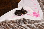 picture of castanets  - Castanets on a handmade embroidered shawl a flamenco stil life  - JPG