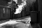 picture of derelict  - Dark mysterious alleyway on a rainy day - JPG