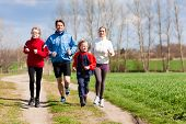Family, mother, father and children are running or jogging for sport outdoors