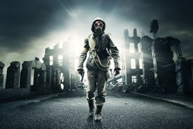 picture of gases  - Post apocalyptic survivor in gas mask destroyed city in the background - JPG