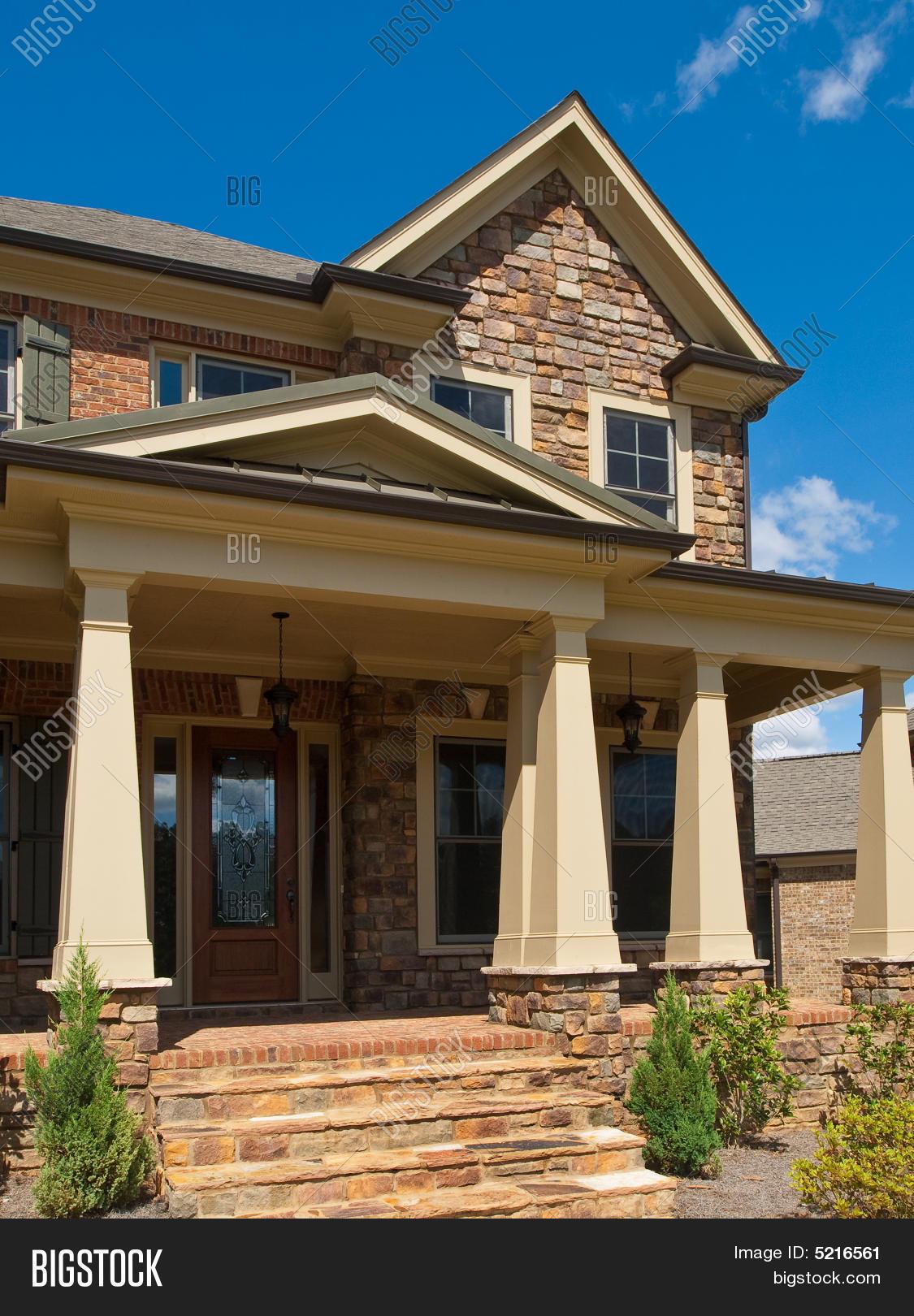 Luxury model home column exterior entrance stock photo for Model home exterior photos