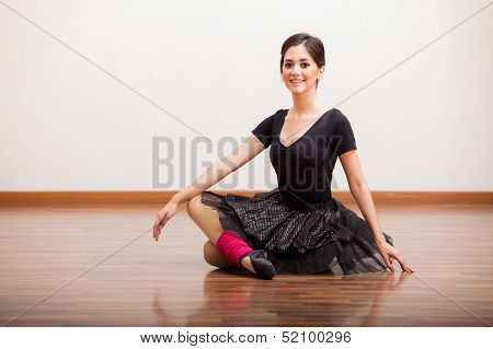 Beautiful ballerina taking a break