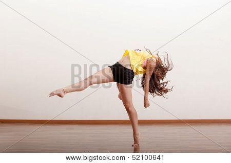 Cute female dancer in a studio