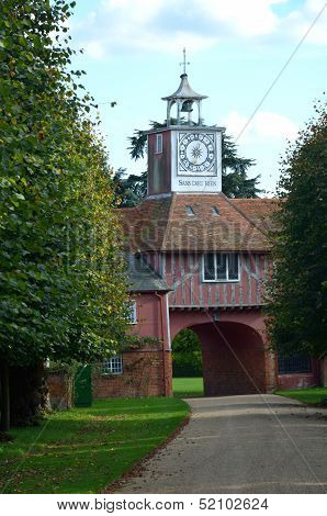 Gatehouse and clock through trees
